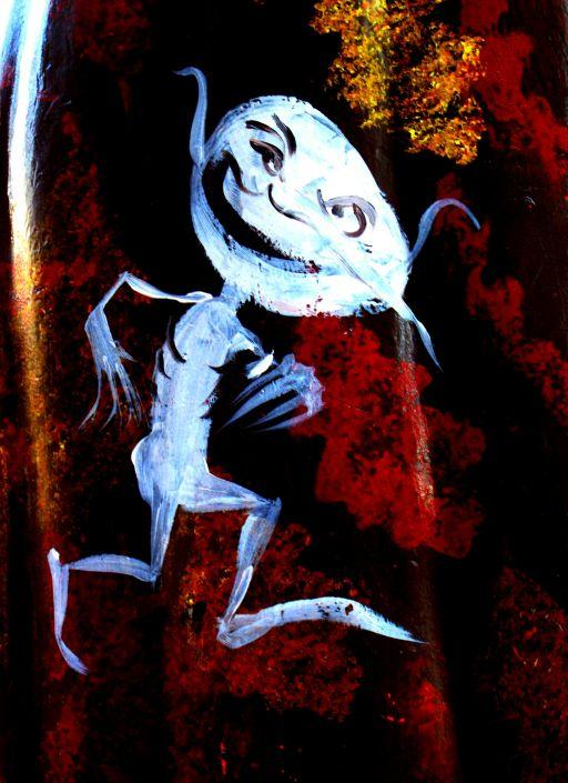 detail of a goblin creature from a painted pumpkin